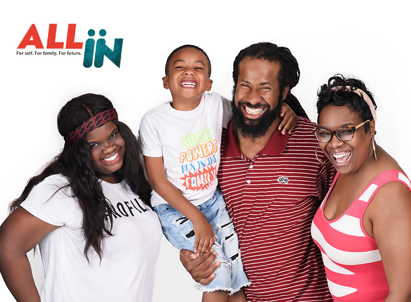 photo of family with All In logo